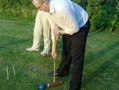 Photograph of Dave playing a croquet shot